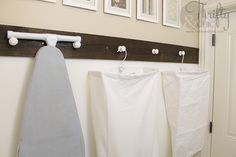 Hang storage bags to maximize the potential of a blank laundry room wall.