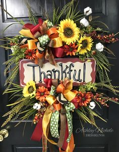 A fun design, our Thankful Fall Floral Wreath features a hand painted wooden sign in the middle of the wreath with beautiful florals, cotton, berries, grass and bows. Built on a 18 round grapevine wreath Thanksgiving Wreaths, Autumn Wreaths, Holiday Wreaths, Spring Wreaths, Summer Wreath, Thanksgiving Parties, Wreath Fall, Thanksgiving Decorations, Holiday Decor