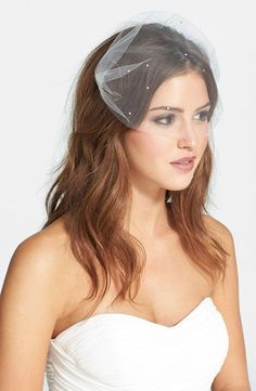 Bride with blusher veil and sweetheart neckline