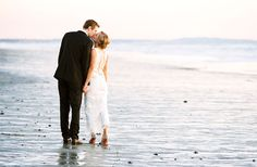 Love this beach wedding shot! In the blog, the bride mentions that it was freezing, though. :)