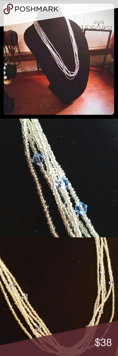 Handmade Jewelry Multiple strands of clear glass seed beads accented with pale blue Swarovski Crystals accented with an antiqued silver clasp. One of kind stand out piece that would be perfect for any occasion. Magen's Fairytale Creations  Jewelry Necklaces