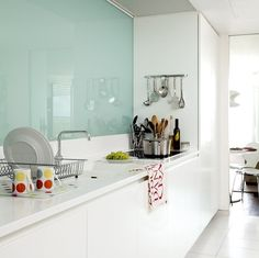 love the glass wall idea but i dont know if i'll give up beautiful spanish tiles for it