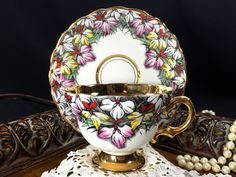Rosina Teacup and Saucer, Rare Gold Banded Hand Painted Chintz Tea Cup Made in England J-1804