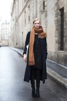 Love the contrast of the camel colored scarf against the black.