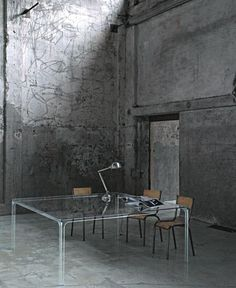 Oscar Glass Table by Piero Lissoni Love the contrast of the rough concrete and the ethereal glass table.
