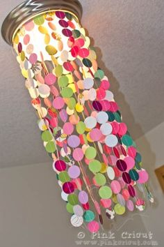 DIY girly chandelier - we made this and it was gorgeous! All blues, greens and whites. We also hung some loops of iridescent bead garland through it. THEN, the hot glue melted and the whole thing slid slowly off in one big glob....so now, we're attaching all the threads to a fry basket (sprayed white) and going to hang it from the light.