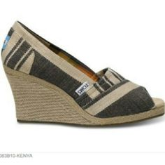 """TOMS Kenya Stripe Espadrille Wedges 7.5 These TOMS Kenya Stripe Espadrille Wedges are a size 7.5 in good used condition. 1st picture is stock phoyo, all other photos are the actual pair you'll receive. No box or dustbag. Great neutral tones of brown, light brown, and tan burlap. 3"""" wedge. ::: Bundle 3+ items from my closet and save 30% off when you use the app's Bundle feature! ::: No trades. TOMS Shoes Wedges"""