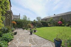 Lovely lawned garden surrounded by stone walls & herbaceous borders- crazy paving adjacent to front of house - Hexhamshire, May '15