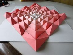 Japanese paper engineer Kota Hiratsuka has been creating beautifully complex origami mosaics that rely on cut and folded geometric patterns.