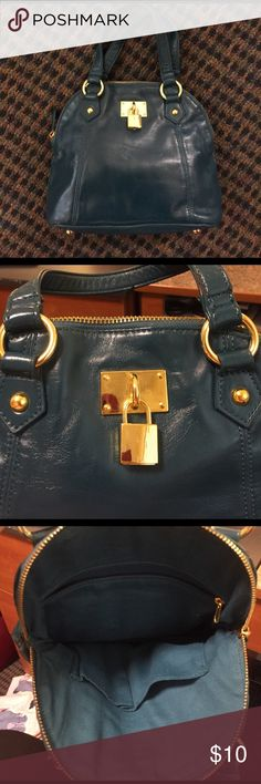 Forever 21 Faux Leather Purse Teal faux leather purse. Minor rips from leather being worn in. Gold hardware. Price is negotiable. No trades. Forever 21 Bags Mini Bags
