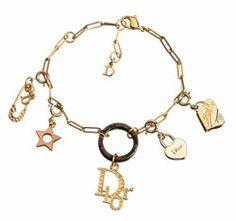 pulsera dorada  Christian Dior