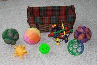 Kosz skarbów z piłkami. Treasure basket with balls.