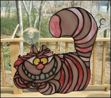 Stained glass Cheshire cat panel.