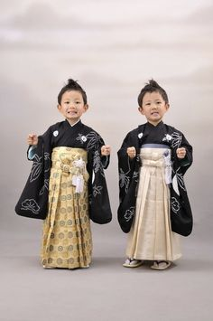 Two Japanese boys offer stiff poses ….a festival (on November 15th) for children of three, five and seven years of age (or more exactl...