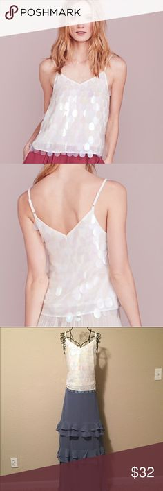 Just In 🌟 LC Lauren Conrad Paillette Tank Be date night ready with this gorgeous tank from LC Lauren Conrad. This shimmery white too will stun your partner. The adjustable straps will give you a perfect fit. NWT, Smoke Free Home LC Lauren Conrad Tops Camisoles