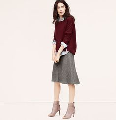 I have a similar skirt, but I've paired in with blouses. I'm interested in trying the baggy sweater over the dress shirt look.