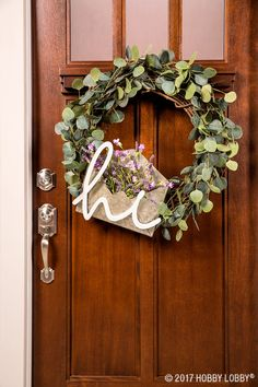Embellish a grapevine wreath with eucalyptus picks and inviting home accents for front door decor that does the welcoming for you. Tip: We used floral wire to attach home accent pieces.