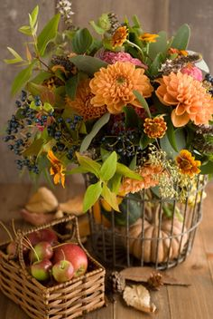 Fall flowers with apples and pumpkin in wire/wooden baskets ...great idea