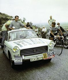Jacques Anquetil and a rather imperious looking director sportif.