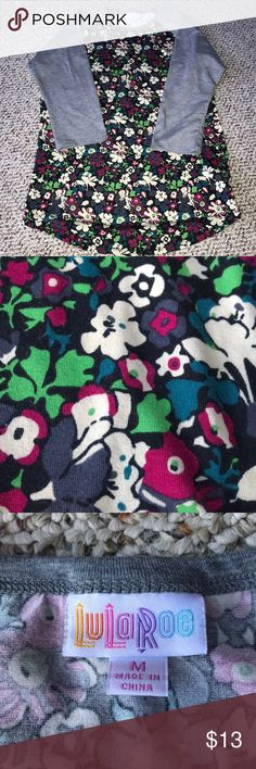 Lularoe Randy Flower printed Lularoe Randy. Has gray sleeves with a flower printed body. New without tags Tops Tees - Long Sleeve