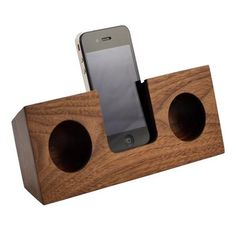 Wooden Amplifier. At home, on the beach or in the woods, you can use this solid wood dock anywhere you go. It acoustically amplifies the iPhone's built-in speaker using hand-cut sound chambers, boosting your device's volume up to four times—all without using electricity.  $100.00