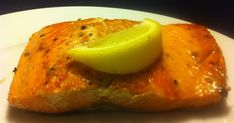 Pan-seared salmon with a wedge of lemon   This recipe is really simple. And really tasty.All you need is a cast iron skillet and some sal...