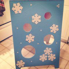 Frozen snowball toss game. Add fake snow & styrofoam balls.