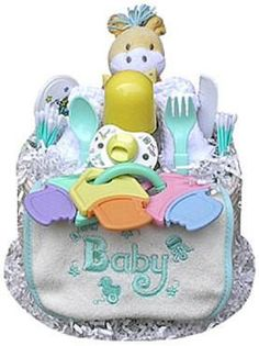 This colorful and fun neutral-themed Diaper Cake is sure to charm the lucky gift recipient! Present one as a baby shower gift, or use it as a creative shower ce