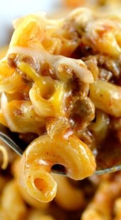 One Skillet Cheesy Chili Mac: Delicious Pasta, Yummy Meaty Chili, and Gooey Cheese.