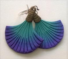 Carved polymer clay earrings by Shelley Atwood