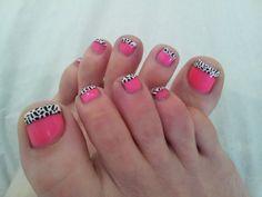 Pretty Pedicure: pink polish with leopard print tips. (Looks like Dalmatian print to me)
