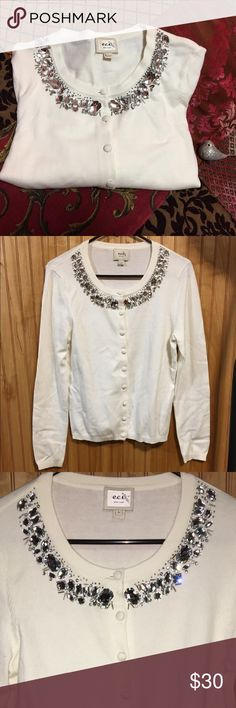 """ECI New York Rhinestone Collar Cardigan Sz L Very elegant rhinestone and bead Embellished Collar Cardigan. Color is white and in excellent used condition. Perfect for the holidays! Measurements taken while laying flat and buttoned: Bust: 37"""", waist/bodice: 35"""", length: 23"""". EUC. Sz L ECI Sweaters Cardigans"""