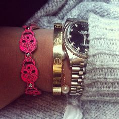 "Rolex watch and Cartier ""love"" bracelet"