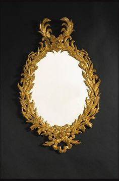 the oval mirror plate within a ribbon-tiedreed and flower-carved border