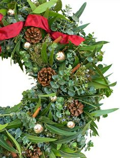 Filled with cheer, the Designer Ornament Eucalyptus Wreath not only reminds you of Christmas with its cheerful pinecones and festive color scheme, but also stirs memories of Christmases past with its subtle fragrance