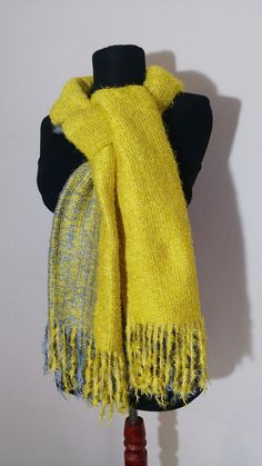 This is woven, multifunctional long mufller which is made of acrylic, soft and fluffy yarns. Color combination: yellow, gray. You can use this item as 3 color combination; yellow - gray - mixed yellow and gray, as you can see from the photos. This item has many of color options on my shop. #wintershawl #longscarf, #yellowscarf #yellowmuffler #fringedmuffler  #fringedscarf #blanketscarf #bohoaccessory  #womenaccessory #wintergift #winteraccessory #giftforher #winteroutfit Boho Accessories, Neckerchiefs, Blanket Scarf, Long Scarf, Elegant Outfit, Neck Warmer, Multifunctional, Yarns, Color Combinations