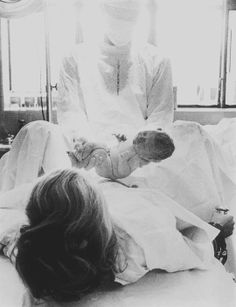 Eve Arnold  View profile  USA. New York. Long Island. Port Jefferson. Childbirth, a baby's first 5 minutes. 1959.