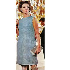 Knitted Shell Evening Dress Pattern.  The lacy blue knit column reflects sparkle of night lights. Delicate pattern is emphasized by plain yoke. A-line shaping is done only by changing size of needle. Hem, neckline, armholes are bound with satin tubing. Wear over a matching blue slip.