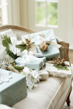 Gift Wrapping Tips from Suzanne Kasler. Pick one theme and carry it through from your decor and right down to your gift wrapping. Whether it's classic red and green or a more neutral white and bronze combination with natural burlap ribbon and gift tags with twine, you can easily mix and match the paper and accessories. Embellish presents with a little extra gift on top, such as a tree ornament. Tie it on the outside with a lovely tag and ribbon — it makes the gift look really special.