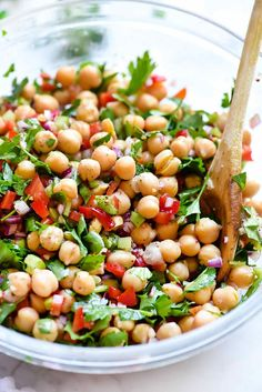 This easy Mediterranean garbanzo bean salad is infused with fresh herbs and a garlicky lemon dressing that ups the crunch for a simple, healthy side dish.