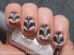 Black and white marble. I don't know how some girls can get the same marble look for each nail. Really well done!