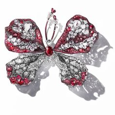 Cindy Chao's The Art Jewel 2015-16 ruby and dimaond butterfly. One of Cindy Chao's trademarks is her annual creation of a Black Label Masterpiece butterfly brooch that are eagerly anticipated by collectors of her work. Discover the jewellery genius who debuted at the Biennale des Antiquaires in Paris 2016: http://www.thejewelleryeditor.com/shop/product/cindy-chao-black-label-winter-leaf-necklace/ #jewelry