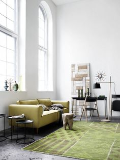 A muted and almost monotone palette with pops of fluoro or grounded with black.