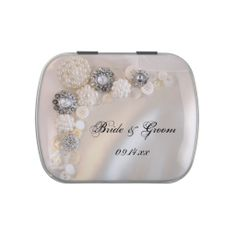 The pretty Pearls and Diamond #Buttons #Wedding Favor Candy Tin is filled with delicious Jelly Belly Candies! Feel free to choose your favorite flavor of jelly beans or mints! This elegant custom button wedding favor features a photograph of white pearl and diamond vintage looking buttons with a white satin background. Perfect for a classy white pearl or button wedding theme. #weddingfavors #buttonwedding #weddingfavor