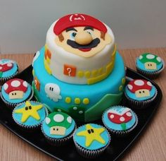 super mario cake cupcakes <Jennifer, just the decorations on the blue part> Super Mario Cupcakes, Super Mario Party, Bolo Super Mario, Mario Birthday Cake, Super Mario Birthday, Boy Birthday Parties, 9th Birthday, Mario Bros Kuchen, Mario Bros Cake