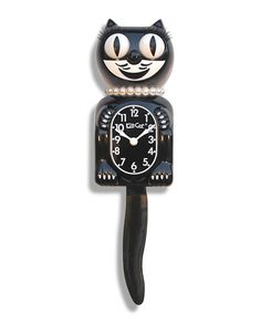 """Limited EditionBlackLadyKit-Cat Clock with Pearl Necklace & Eyelashes Powered by 2 """"C"""" batteries (not included) Classic Black Kit-Cat has been bringing time to life for over 80 years! Now the Lady makes her debut in formal black with pearls…These smiling, tail-wagging clocks are a playful touch on your walls, and their timeless design introduces an …"""
