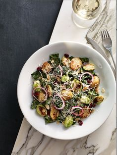 WARM KALE SALAD   1 tbsp (30 ml) vegetable oil 1 cup (250 ml) blanched and halved brussels sprouts 1 cup (250 ml) blanched and halved mini new potatoes Brown Butter Vinaigrette (recipe follows) 1 lb (450 g) Russian kale ½ cup (125 ml) finely grated parmesan cheese, divided ¼ cup (60 ml) toasted …