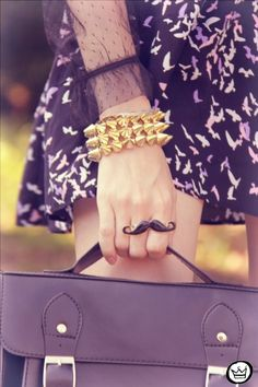 moustache ring, studs, lace.  eclectic at its best.