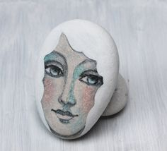 This is a beautiful stone polished by the Mediterranean sea,  I have found it on the beach of Marina di Carrara,Italy.  Carrara is a city of white marble used by Michelangelo for his wonderful sculptures    This pebble has been lovingly hand painted with fine art quality acrylic.    Original design! one of a kind!     My pebbles are finished with mat protection,and are fade and moisture resistant, however, do not immerse in water. Each pebble is signed and dated on the back.    Date of…