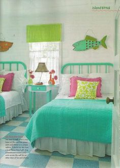 Jane Coslick uses white quilts then accessorizes with colorful throws and lamps and wall art.